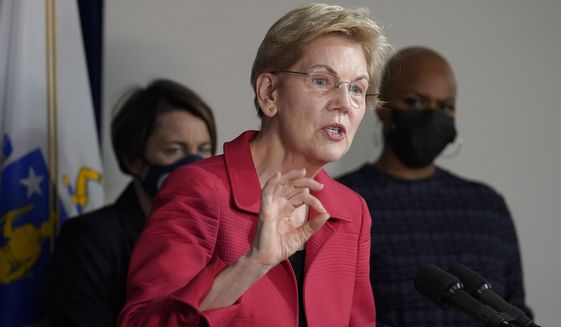U.S. Sen. Elizabeth Warren, D-Mass., center, responds to questions from reporters as Mass. Attorney General Maura Healey, left, and U.S. Rep. Ayanna Pressley, D-Mass., right, look on during a news conference Thursday, April 1, 2021, in Boston. The news conference was held to call on President Biden to use the Higher Education Act to cancel a share of student loan debt for students with federal loans. (AP Photo/Steven Senne)