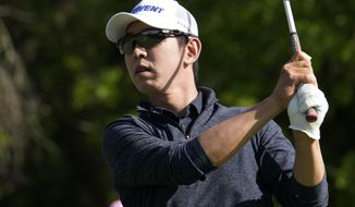 Seung-Yul Noh, of South Korea, watches his drive on the ninth hole during the first round of the Texas Open golf tournament, Thursday, April 1, 2021, in San Antonio. (AP Photo/Eric Gay)