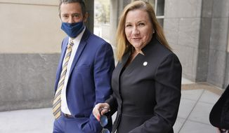 Virginia State Sen. Amanda Chase, R-Chesterfield, right, leaves court with her attorney Tim Anderson during a break in a hearing to dismiss here lawsuit in Federal court in Richmond, Va., Thursday, April 1, 2021. . (AP Photo/Steve Helber)