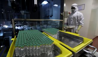 Vials of AstraZeneca's COVISHIELD vaccine for COVID-19 are seen at a filling lab at the Serum Institute of India, Pune, India, Thursday, Jan. 21, 2021. Experts say there is a pressing need for India to bolster vaccination, which started sluggishly in January. The country is expanding its drive to include everyone over 45 from Thursday, April 1. Spotlight on Serum Institute of India - the world's largest maker of vaccines and key global supplier - to cater to cases at home has resulted in delays of global shipments of up to 90 million doses under the U.N.-backed COVAX program, an initiative devised to give countries access to vaccines regardless of their wealth. (AP Photo/Rafiq Maqbool)