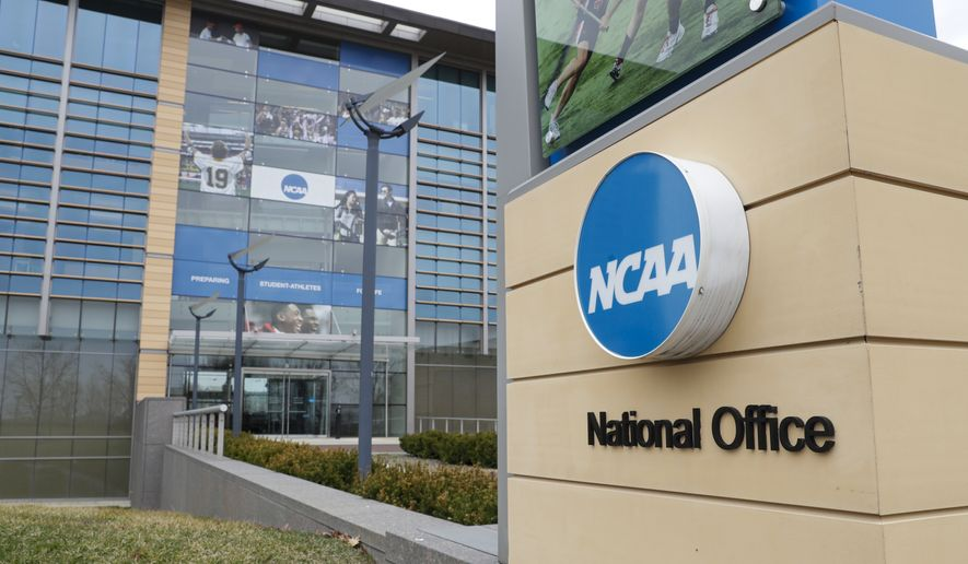 The NCAA headquarters in Indianapolis is shown in this Thursday, March 12, 2020, file photo.  (AP Photo/Michael Conroy, File) **FILE**