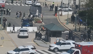 Police respond to a vehicle that rammed a barricade at the U.S.  Capitol, April 2, 2021. (Staff photo: Kery Murakami)
