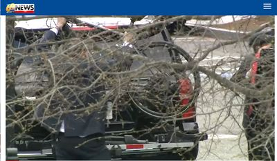 A member of U.S Secretary of Transportation Pete Buttigieg's security detail takes a bike off an SUV, April 1, 2021. Mr. Buttigieg then used the bike to travel a short distance to a Cabinet meeting. (Image: WFMZ-TV 69 video screenshot)
