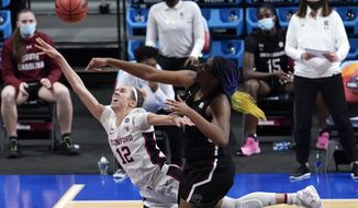 South Carolina forward Aliyah Boston, right, blocks a shot by Stanford guard Lexie Hull (12) during the first half of a women's Final Four NCAA college basketball tournament semifinal game Friday, April 2, 2021, at the Alamodome in San Antonio. (AP Photo/Eric Gay)
