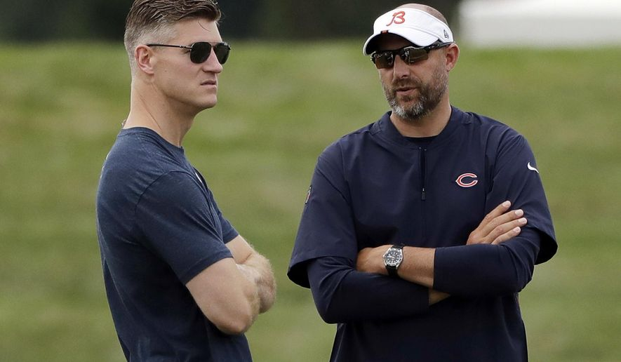 FILE - In this July 26, 2019, file photo, Chicago Bears head coach Matt Nagy, right, talks with general manager Ryan Pace during NFL football training camp in Bourbonnais, Ill. Coach Matt Nagy is ready to call plays again on offense for the Chicago Bears. Nagy said Friday, April 2, 2021, he is taking back those duties after handing them off to offensive coordinator Bill Lazor midway through last season in an effort to shake up a struggling team. Chairman George McCaskey opted to stick with Nagy and Pace, citing their leadership and the way the team handled the big losing streak last season. (AP Photo/Nam Y. Huh, File)