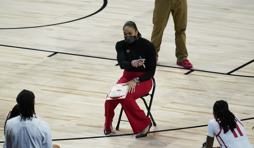 Georgia head coach Joni Taylor, center, talks to her team during a timeout in the first half of a college basketball game against Oregon in the second round of the women's NCAA tournament at the Alamodome in San Antonio, Wednesday, March 24, 2021. (AP Photo/Eric Gay)