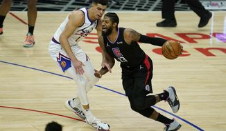 Denver Nuggets forward Michael Porter Jr. (1) defends against LA Clippers guard Paul George (13) during the second quarter of an NBA basketball game Thursday, April 1, 2021, in Los Angeles. (AP Photo/Ashley Landis)