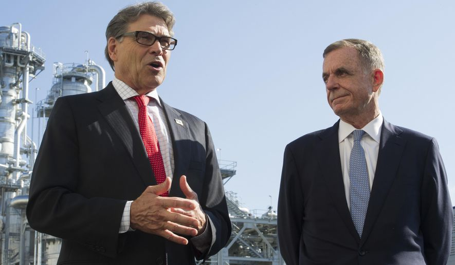 FILE - In this Thursday, July 26, 2018 file photo, Secretary of Energy Rick Perry, left, with the main cyrogenic heating exchange behind him, and Thomas Farrell, II, chairman, president and CEO, Dominion Energy, speak with reporters at Dominion Energy's Cove Point LNG liquefaction Project facility in Lusby, Md., Tom Farrell, who led Dominion Energy for more than a decade, has died Friday, April 2, 2021 one day after he stepped down from his post. He was 66. (AP Photo/Cliff Owen, File)