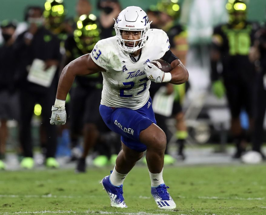 FILE - In this Oct. 23, 2020, file photo, Tulsa linebacker Zaven Collins (23) runs back an interception for a touchdown against South Florida during an NCAA football game in Tampa, Fla. Collins has gone from having college coaches telling him he's not good enough for a Division I scholarship to having every NFL team show up at his Pro Day. (AP Photo/Mark LoMoglio, File)