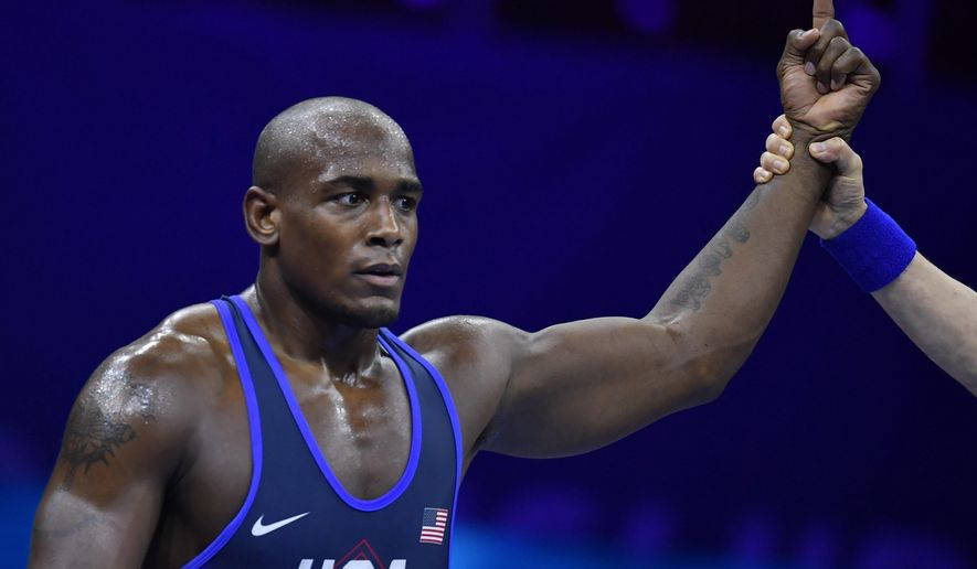 FILE - J'Den Cox of the United States celebrates his win over Ivan Yankouski of Belarus in the final of men's freestyle 92kg category of the Wrestling World Championships in Budapest, Hungary, in this Monday, Oct. 22, 2018, file photo. Two-time world champion and 2016 Olympic bronze medalist J'den Cox is out of the U.S. Olympic wrestling trials in Fort Worth, Texas, after not making weight Friday, April 2, 2021, USA Wrestling announced. (Tibor Illyes/MTI via AP, File)