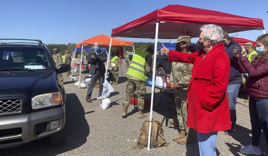 Alabama Gov. Kay Ivey gives a thumbs up to people in line to get COVID-19 vaccinations at an Alabama National Guard clinic in Camden, Ala., on Friday, April 2, 2021. (AP Photo/Kim Chandler) ** FILE **
