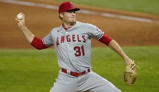 FILE - In this Sept. 10, 2020, file photo, Los Angeles Angels relief pitcher Ty Buttrey throws to a Texas Rangers batter during the ninth inning of a baseball game in Arlington, Texas. Buttrey has retired from baseball, saying he has lost his affection for the game. (AP Photo/Tony Gutierrez, File)