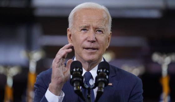 FILE - In this March 31, 2021, file photo President Joe Biden delivers a speech on infrastructure spending at Carpenters Pittsburgh Training Center in Pittsburgh. (AP Photo/Evan Vucci, File)