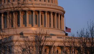 The American flag at the U.S. Capitol flies at half-staff in honor of Capitol Police officer William Evans who was killed after a man rammed a car into two officers at a barricade outside the U.S. Capitol in Washington, Friday, April 2, 2021. (AP Photo/Alex Brandon)