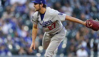 Los Angeles Dodgers starting pitcher Trevor Bauer works against the Colorado Rockies in the first inning of a baseball game Friday, April 2, 2021, in Denver. (AP Photo/David Zalubowski)