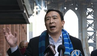 FILE - In this March 11, 2021 file photo, Democratic mayoral candidate Andrew Yang holds a news conference in the Dumbo neighborhood of New York.  Yang has resumed campaigning a day after going to the hospital for a kidney stone. Yang's campaign said Saturday, April 3,  that he planned to visit an Easter egg hunt at the Queens County Farm and meet with campaign volunteers at Open Streets locations in Brooklyn.  (AP Photo/Mark Lennihan, File)