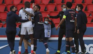 PSG's Neymar, center, talks with Lille's Tiago Djalo after he receives a red card from referee during the French League One soccer match between Paris Saint Germain and Lille, at the Parc des Princes stadium, in Paris, France, Saturday, April. 3, 2021. (AP Photo/Christophe Ena)