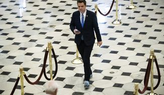 FILE - In this Dec. 18, 2019, file photo Rep. Matt Gaetz, R-Fla., walks off the House floor as House of Representatives takes up articles of impeachment against President Donald Trump on Capitol Hill in Washington. (AP Photo/Matt Rourke, File)