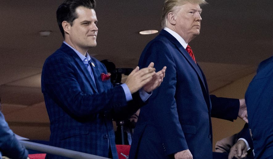 FILE - In this Oct. 27, 2019, file photo President Donald Trump, right, accompanied by Rep. Matt Gaetz, R-Fla., left, arrive for Game 5 of the World Series baseball game between the Houston Astros and the Washington Nationals at Nationals Park in Washington. (AP Photo/Andrew Harnik, File)