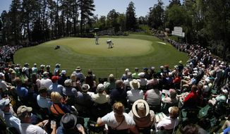 FILE - In this April 5, 2018, file photo, Bubba Watson putts on the sixth hole during the first round at the Masters golf tournament in Augusta, Ga. The sixth hole is statistically the easiest of the par-3s at Augusta National. (AP Photo/Charlie Riedel, File)