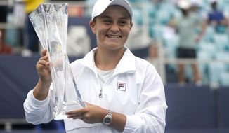 Ashleigh Barty of Australia poses with the trophy after winning her match against Bianca Andreescu of Canada during the finals at the Miami Open tennis tournament, Saturday, April 3, 2021, in Miami Gardens, Fla. Barty won 6-3, 4-0, as Andreescu retired due to injury. (AP Photo/Lynne Sladky)