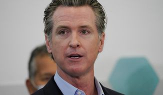 Governor Gavin Newsom speaks with news reporters at Park de la Cruz Recreation Center on Friday, April 2, 2021, about San Diego's newest pop-up vaccination site in the City Heights neighborhood. (Nelvin C. Cepeda/The San Diego Union-Tribune via AP)