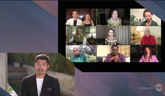 In this video grab provided by the SAG Awards, Henry Golding presents an award as nominees appear on screen during the 27th annual Screen Actors Guild Awards on April 4, 2021. (SAG Awards via AP)