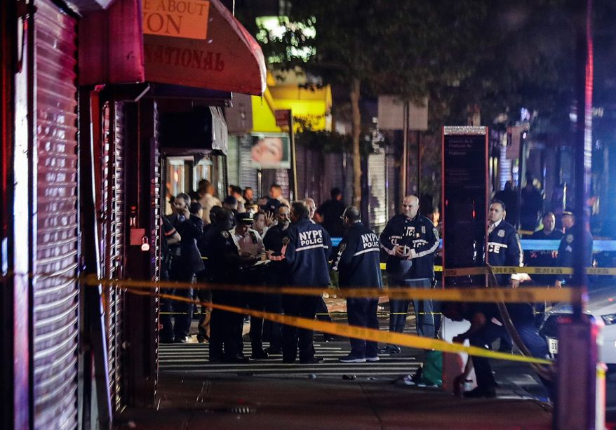 In this June 4, 2020, file photo, New York City police officers gather near the site of a shooting in the Brooklyn borough of New York.  (AP Photo/Frank Franklin II, File)