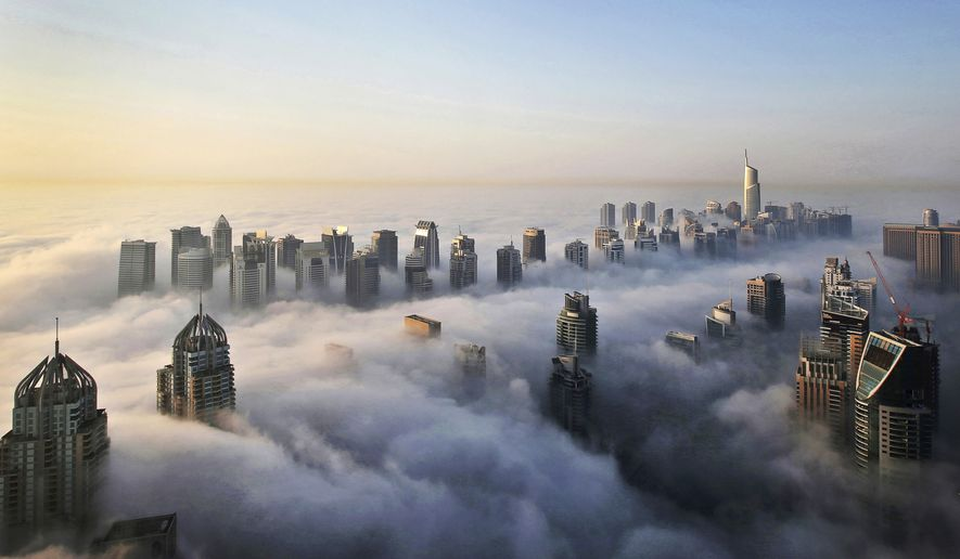 A thick blanket of early morning fog partially shrouds the skyscrapers of the Marina and Jumeirah Lake Towers districts of Dubai, United Arab Emirates. (AP Photo/Kamran Jebreili, File)