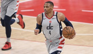 Washington Wizards guard Russell Westbrook (4) dribbles the ball during the first half of an NBA basketball game against the Dallas Mavericks, Saturday, April 3, 2021, in Washington. (AP Photo/Nick Wass)