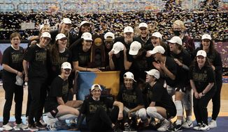 Stanford players celebrate with the trophy after the championship game against Arizona in the women's Final Four NCAA college basketball tournament, Sunday, April 4, 2021, at the Alamodome in San Antonio. Stanford won 54-53. (AP Photo/Morry Gash) **FILE**