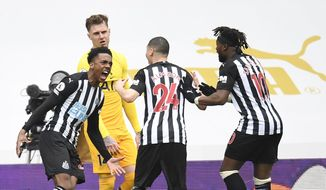 Newcastle's Joe Willock, left, celebrates with teammates after scoring his side's second goal during the English Premier League soccer match between Newcastle United and Tottenham Hotspur at St. James' Park in Newcastle, England, Sunday, April 4, 2021. (Peter Powell/Pool via AP)