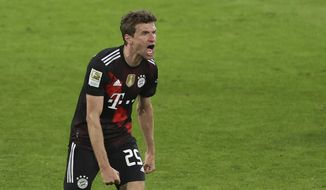 Bayern's Thomas Mueller shouts out and celebrates after the end of the German Bundesliga soccer match between RB Leipzig and Bayern Munich, in Leipzig, Germany, Saturday, April 3, 2021. Bayern won the game 1-0, with Bayern's Leon Goretzka scoring the only goal . (Alexander Hassenstein/ Pool via AP)