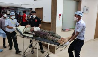A paramilitary soldier injured in a gunbattle with Maoist rebels on Saturday is brought for treatment at a hospital in Raipur, India, Sunday, April 4, 2021.  India on Sunday recovered the bodies of 20 police and paramilitary troops who were killed in a gunbattle with Maoist rebels a day earlier in the forests of the eastern Chhattisgarh state. (AP Photo)