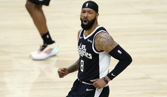 Los Angeles Clippers forward Marcus Morris Sr. reacts after scoring against the Los Angeles Lakers during the first half of an NBA basketball game Sunday, April 4, 2021, in Los Angeles. (AP Photo/Marcio Jose Sanchez)