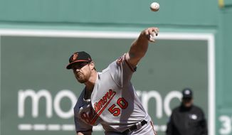 Baltimore Orioles' Bruce Zimmermann delivers a pitch against the Boston Red Sox during the first inning of a baseball game, Sunday, April 4, 2021, in Boston. (AP Photo/Steven Senne)