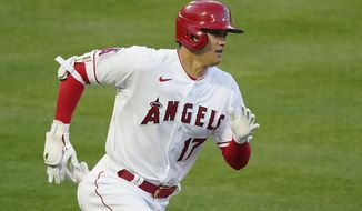 Los Angeles Angels designated hitter Shohei Ohtani (17) runs to first after hitting a triple in the first inning of an MLB baseball game against the Chicago White Sox Friday, April 2, 2021, in Anaheim, Calif. (AP Photo/Ashley Landis)