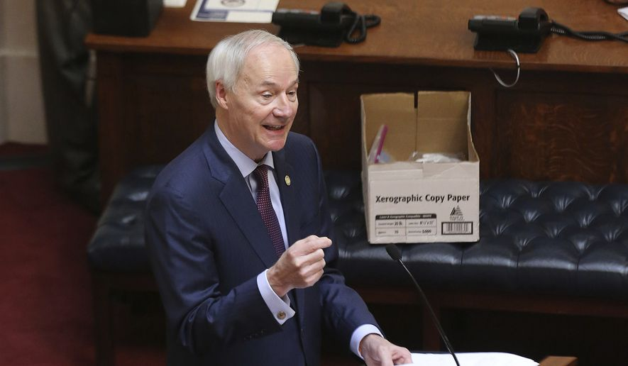In this April 8, 2020, file photo, Arkansas Gov. Asa Hutchinson gives the State of the State in the Senate chamber of the state Capitol in Little Rock, Ark. Hutchinson vetoed legislation that would have made his state the first to ban gender-confirming treatments for transgender youth. (Tommy Metthe/Arkansas Democrat-Gazette via AP, File)