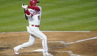 Los Angeles Angels' Shohei Ohtani (17) bats during a baseball game against the Chicago White Sox Sunday, April 4, 2021, in Anaheim, Calif. (AP Photo/Ashley Landis)