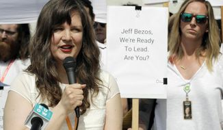 FILE - Emily Cunningham, left, speaks as Kathryn Dellinger, right, looks on during a news conference following Amazon's annual shareholders meeting, Wednesday, May 22, 2019, in Seattle. The National Labor Relations Board has found that two outspoken Amazon workers were illegally fired last year. Both employees, Emily Cunningham and Maren Costa, worked at Amazon offices in Seattle and publicly criticized the company, pushing it to do more to reduce its impact on climate change and to better protect warehouse workers from the coronavirus. The NLRB confirmed Monday, April 5, 2021 that it found merit in the case. (AP Photo/Ted S. Warren, file)