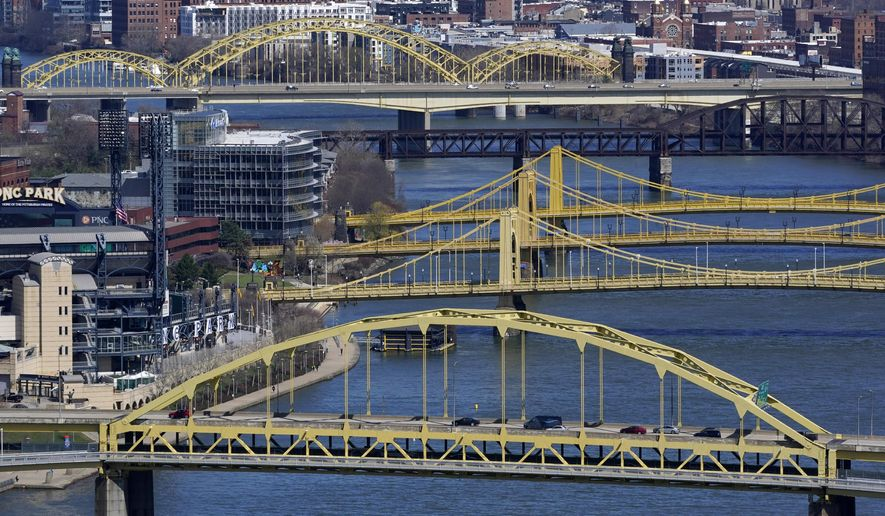 FILE - This April 2, 2021, file photo shows bridges spanning the Allegheny River in downtown Pittsburgh. Republicans in Congress are making the politically brazen bet that it's more advantageous to oppose President Joe Biden's ambitious rebuild America agenda than to lend support for the costly $2.3 trillion undertaking for roads, bridges and other infrastructure investments. (AP Photo/Gene J. Puskar, File)