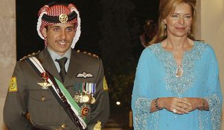 CORRECTS NAME TO PRINCE HAMZAH --  FILE - In this May 27, 2004 file photo, Jordan's Prince Hamzah left, with his mother Queen Noor, stands during his wedding ceremony in Amman, Jordan. Prince Hamzah, the half-brother of Jordan's King Abdullah II, said he has been placed under house arrest in a videotaped statement late Saturday, April 3, 2021. (AP Photo/Hussein Malla, File)