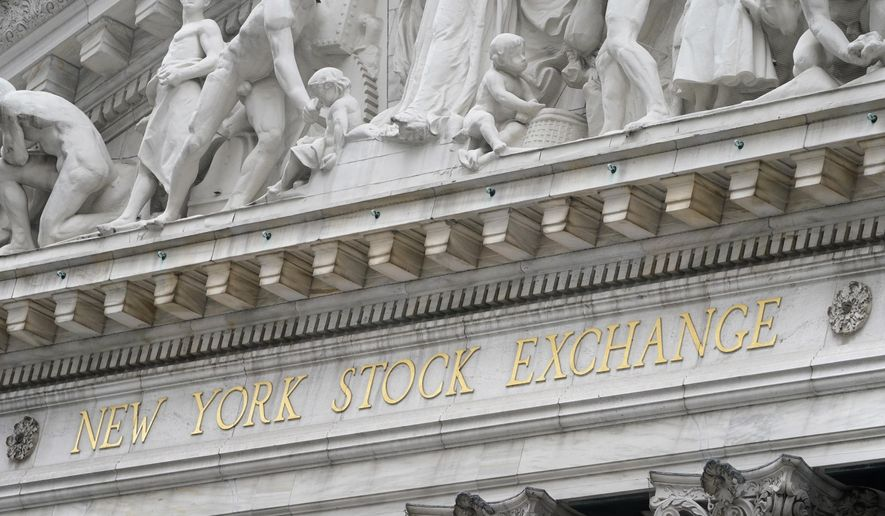 FILE - In this Nov. 23, 2020 file photo, stone sculptures adorn the New York Stock Exchange. Stocks are off to a strong start on Wall Street Monday, April 5, 2021, putting the S&P 500 on track to beat the record high it set last week.  (AP Photo/Seth Wenig, File)