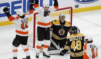 Philadelphia Flyers' James van Riemsdyk (25) and Nolan Patrick (19) celebrate the goal on Boston Bruins' Dan Vladar (80) by Sean Couturier (14) during the third period of an NHL hockey game, Monday, April 5, 2021, in Boston. (AP Photo/Michael Dwyer)