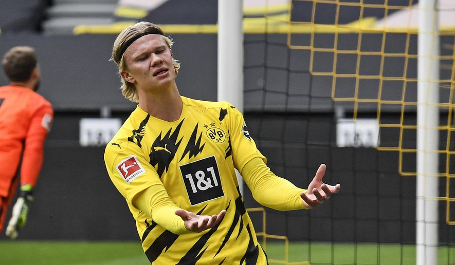 Dortmund's Erling Haaland reacts after missing a chance during the German Bundesliga soccer match between Borussia Dortmund and Eintracht Frankfurt in Dortmund, Germany, Saturday, April 3, 2021. (AP Photo/Martin Meissner, Pool)