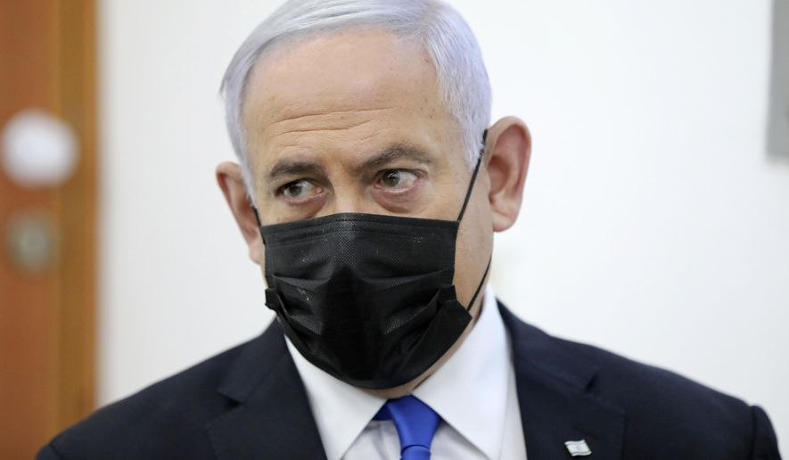 Israeli Prime Minister Benjamin Netanyahu attends a hearing evidence stage for his trial over alleged corruption crimes, at the Jerusalem district court, in Salah El-Din, East Jerusalem, Monday, April 5, 2021. Netanyahu was back in court for his corruption trial on Monday as the country's political parties were set to weigh in on whether he should form the next government after a closely divided election or step down to focus on his legal woes. (Abir Sultan/Pool Photo via AP)