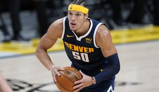 Denver Nuggets forward Aaron Gordon looks to pass the ball during the second half of the team's NBA basketball game against the Orlando Magic on Sunday, April 4, 2021, in Denver. (AP Photo/David Zalubowski)