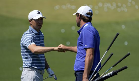 Jordan Spieth and Scottie Scheffler meet the range during a practice day for the Masters golf tournament on Monday, April 5, 2021, in Augusta, Ga. (AP Photo/David J. Phillip)
