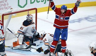 Montreal Canadiens' Josh Anderson celebrates his goal past Edmonton Oilers goaltender Mike Smith during the third period of an NHL hockey game in Montreal on Monday, April 5, 2021. (Paul Chiasson/The Canadian Press via AP)