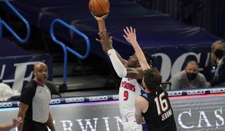 Detroit Pistons forward Jerami Grant (9) shoots in front of Oklahoma City Thunder guard Ty Jerome (16) in the first half of an NBA basketball game Monday, April 5, 2021, in Oklahoma City. (AP Photo/Sue Ogrocki)